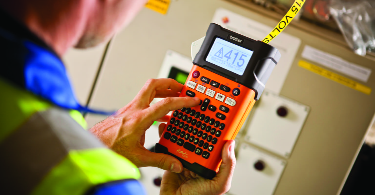 Electrician using Brother PT-E300 to print labels