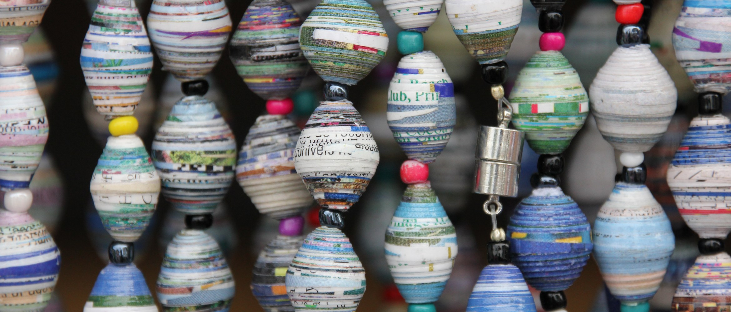 Used paper has been recycled and repurposed to craft environmentally friendly sustainable hanging decorations