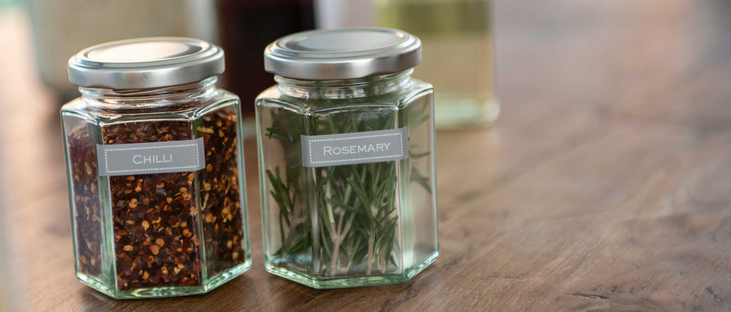 White text on grey labels, applied to jars to identify contents as chilli and rosemary