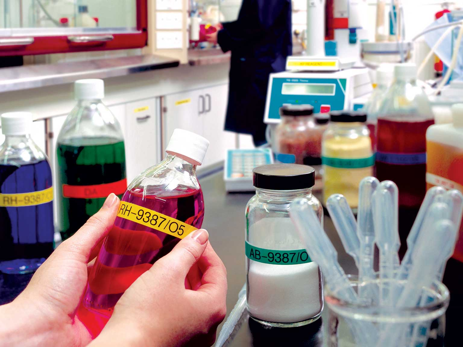 Brother P-touch laminated TZe labels on various chemicals in a laboratory