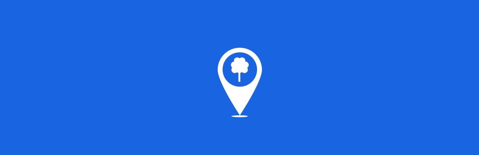 blå firkant med hvidt logo for træmarkering
