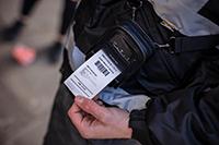 RJ 2 inch printing receipt on shoulder strap on enforcement officer