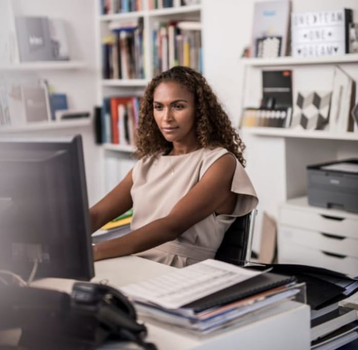 Woman in office working on computer