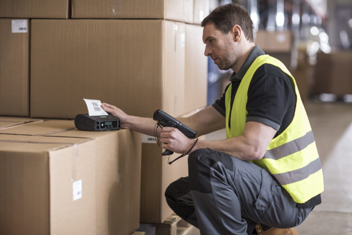 Brother RJ-4230B and man in warehouse