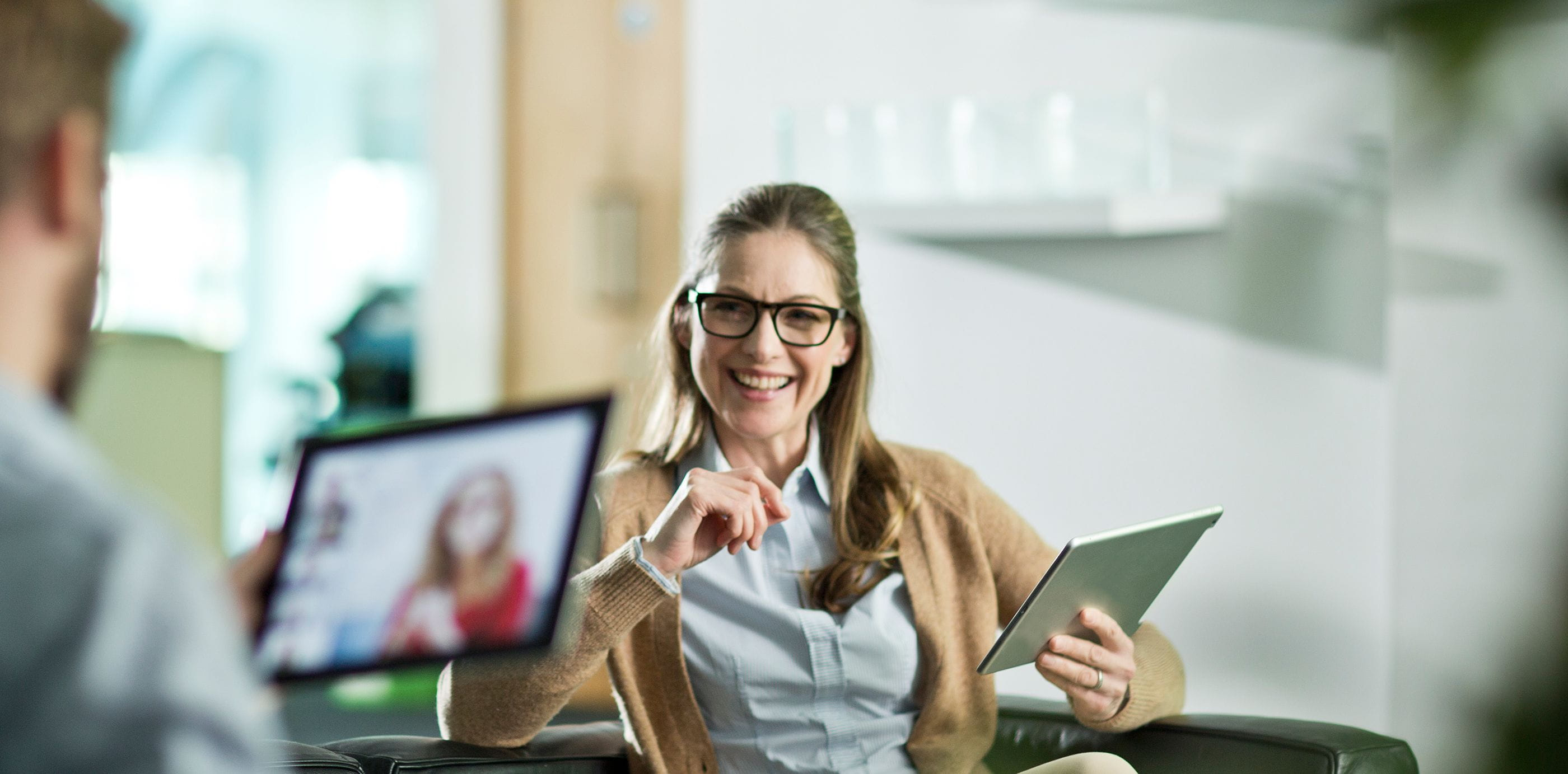 Brother OmniJoin woman and man using tablets for web conferencing