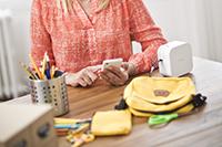 Brother PT-P900W label printer on desk