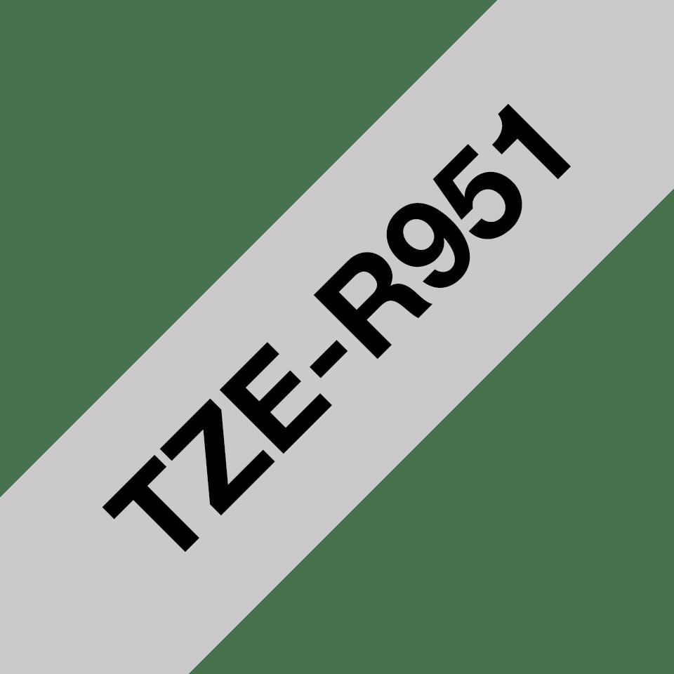 Originalt Brother TZe-R951 satinbånd – Sort på sølv, 24 mm bredt